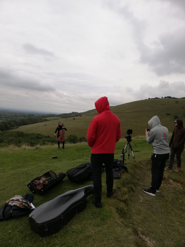 Video shoot for' Butterfly' single up on a cold and windy South Downs near Brighton, UK